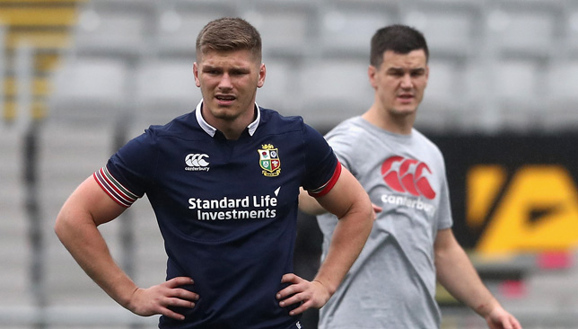 Owen Farrell looks on with Jonathan Sexton during a kicking session at Eden Park.