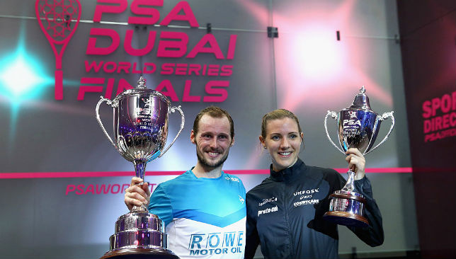 Gaultier and Laura Massaro pose with their 2016 PSA Dubai World Series Finals 2016 trophies.