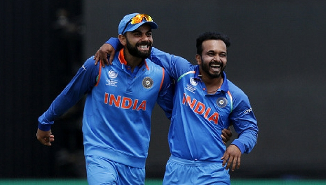 Kedar Jadhav celebrates with Virat Kohli after taking a wicket [Getty Images]
