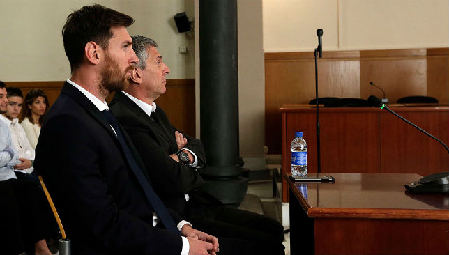 Lionel Messi and his father Jorge Horacio Messi attend a trial in court.