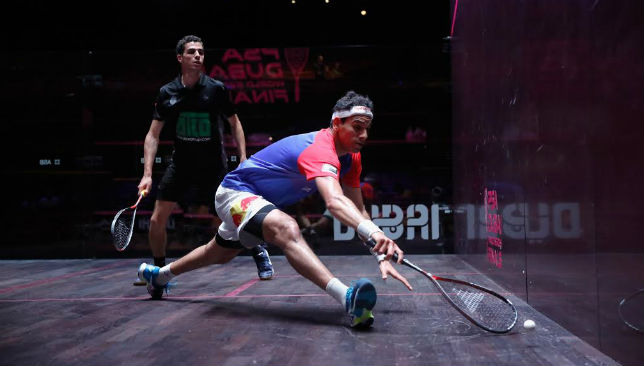 Mohamed El Shorbagy (blue) in action against Ali Farag.