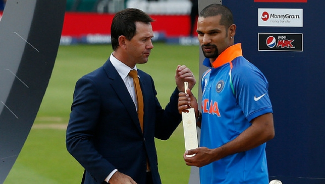 Shikhar Dhawan receives the Golden Bat trophy from Ricky Ponting [Getty Images]