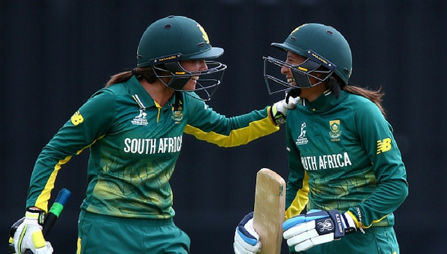 Shabnim Ismail (R) celebrates with Sune Luus after hitting the winning runs.