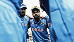 India captain Virat  Kohli (R) talks to his players ahead of a Champions Trophy match [Getty Images]