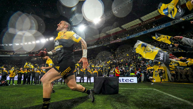 TJ Perenara runs on to the pitch during the 2016 Super Rugby Final match between the Hurricanes and the Lions.