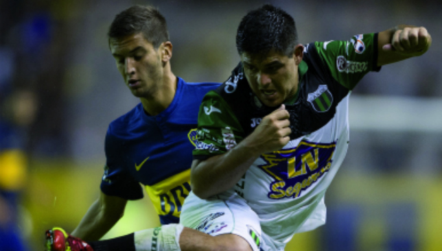 Winging in: Alejandro Gagliardi (r) in action against Boca juniors (Getty).
