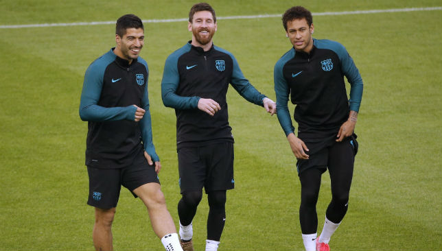 Barcelona's Lionel Messi (C), Luis Suarez (L) and Neymar.