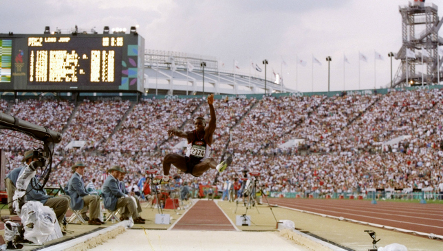 Lewis on his way to a fourth straight long jump gold medal at the Atlanta Olympics