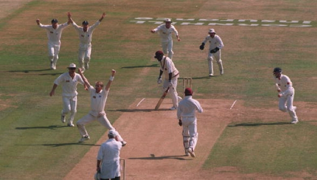 Dominic Cork celebrates after picking up a hat-trick against West Indies in 1995.