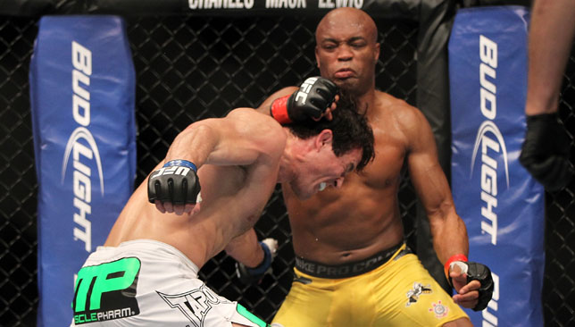 nderson Silva (right) punches Chael Sonnen at UFC 148.