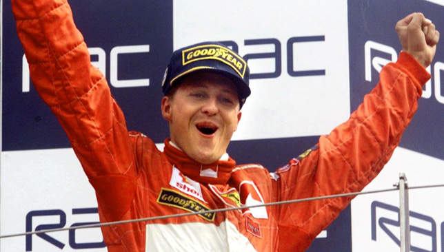 Winner German Michael Schumacher waves to the crow