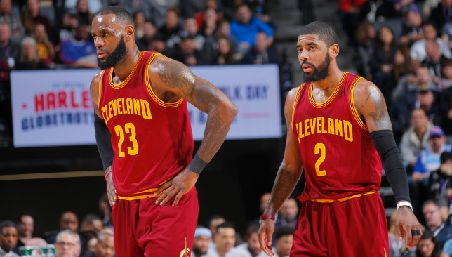 Poles apart: LeBron James and Kyrie Irving. Picture: Getty Images.