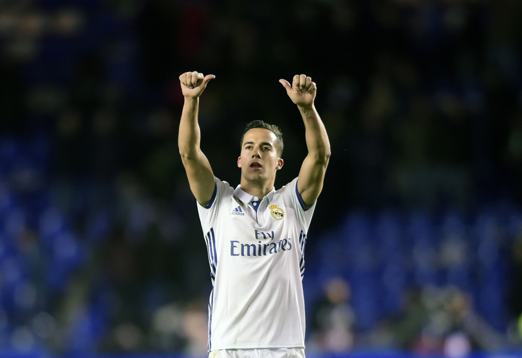 Real Madrid's midfielder Lucas Vazquez celebrates at the end of the Spanish league football match RC Deportivo vs Real Madrid CF at the Municipal de Riazor stadium in La Coruna on April 26, 2017. / AFP PHOTO / MIGUEL RIOPA (Photo credit should read MIGUEL RIOPA/AFP/Getty Images)