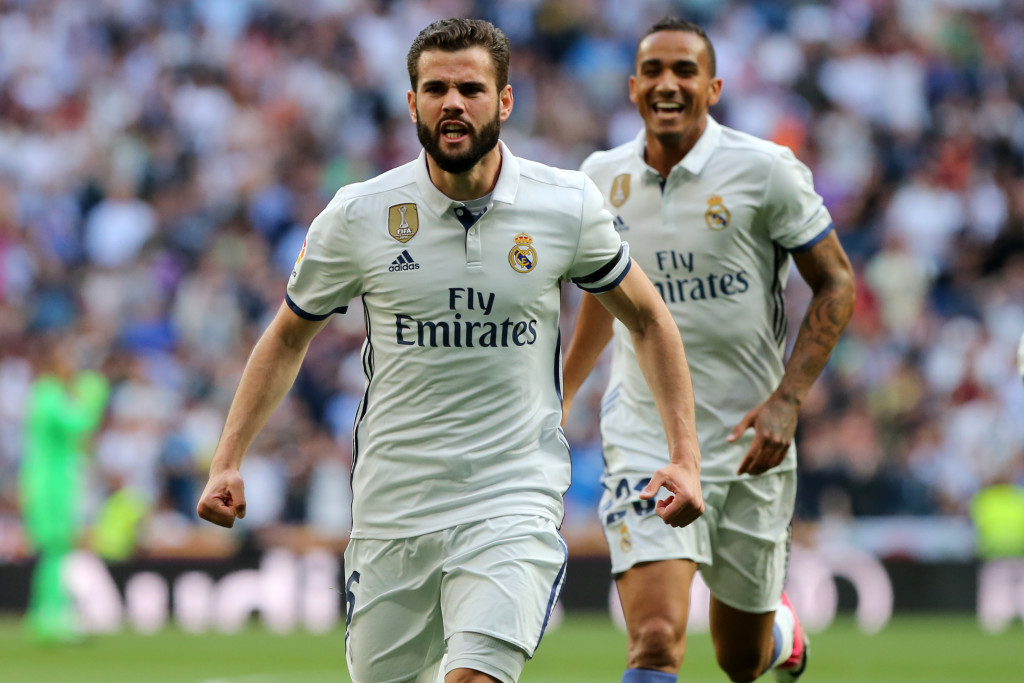 Real Madrid's defender Nacho Fernandez (L) celebrates a goal during the Spanish league football match Real Madrid CF vs Sevilla FC at the Santiago Bernabeu stadium in Madrid on May 14, 2017. / AFP PHOTO / CESAR MANSO (Photo credit should read CESAR MANSO/AFP/Getty Images)