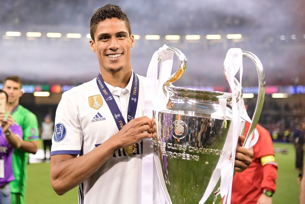 Real Madrid's French defender Raphael Varane lifts the trophy after Real Madrid won the UEFA Champions League final football match between Juventus and Real Madrid at The Principality Stadium in Cardiff, south Wales, on June 3, 2017. / AFP PHOTO / JAVIER SORIANO (Photo credit should read JAVIER SORIANO/AFP/Getty Images)