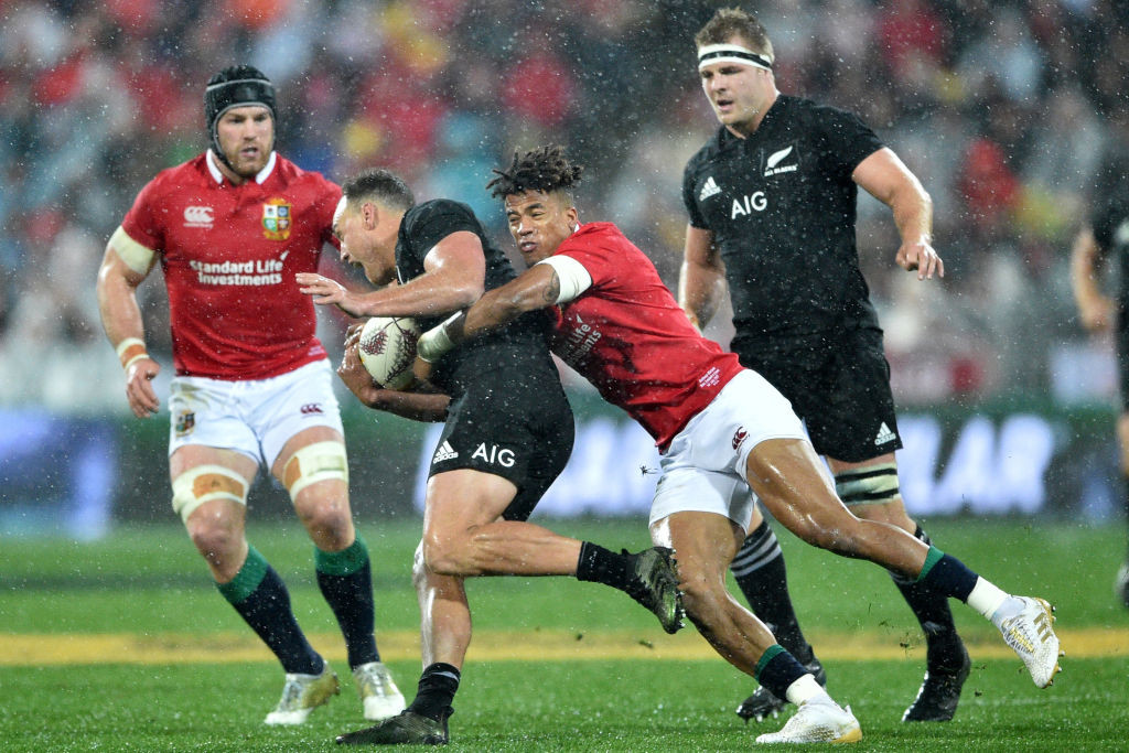 Lions' Anthony Johnson tackles All Blacks' Israel Dagg.