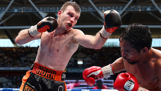 Horn punches Pacquiao during their WBO World Welterweight title fight.