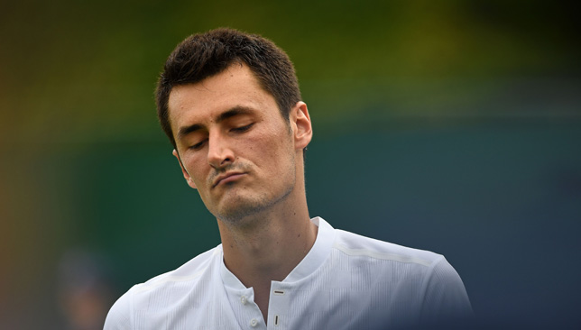 Bernard Tomic acts like a spoiled child after losing at Wimbledon