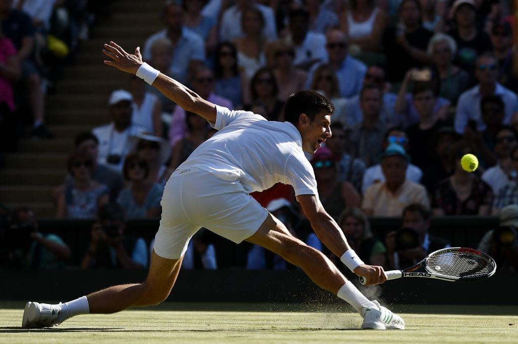Sliding into the second week: Novak Djokovic.