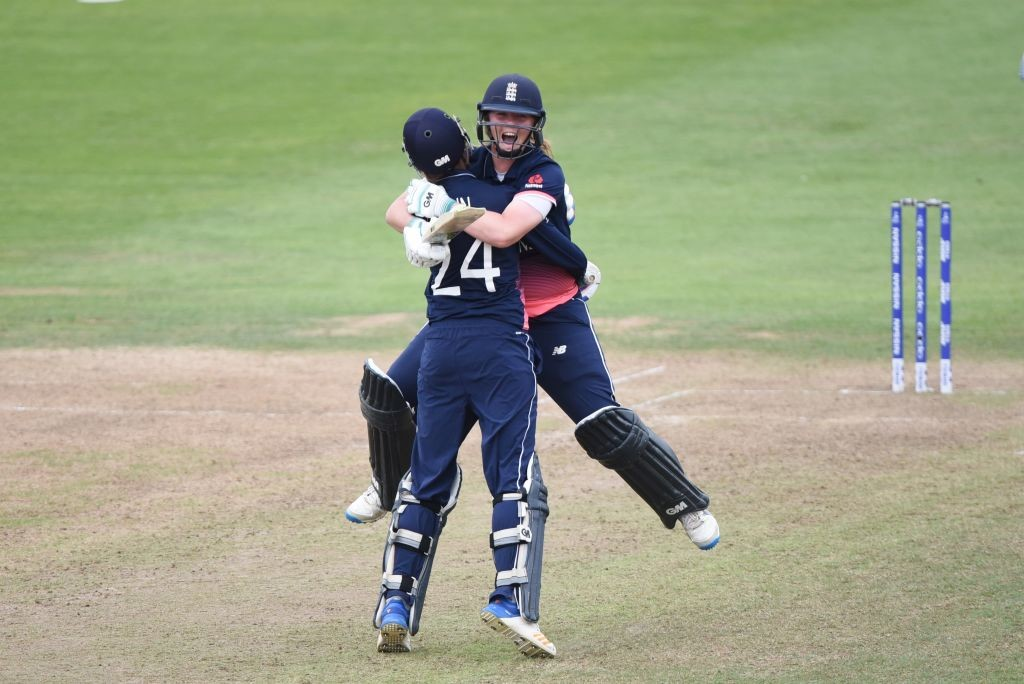 Anya Shurbsole celebrates with Jenny Gunn after hitting the winning boundary.