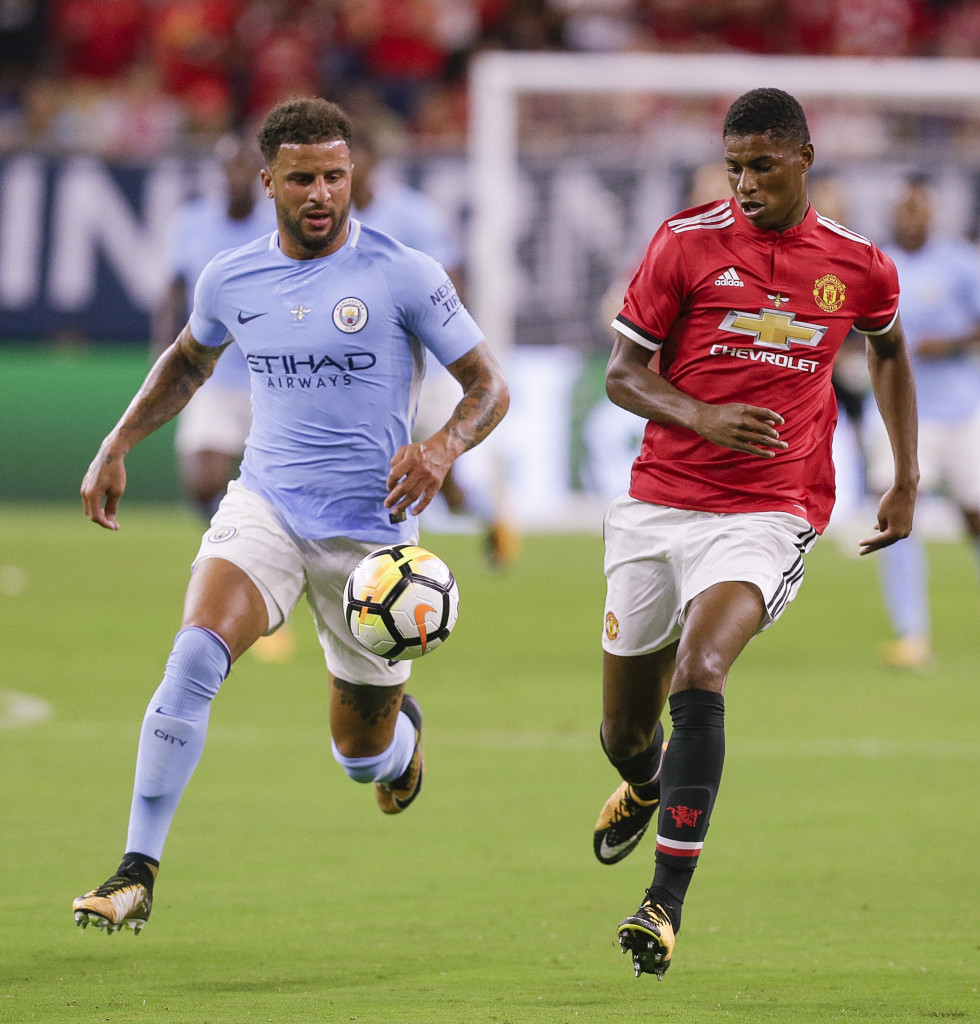 HOUSTON, TX - JULY 20: Marcus Rashford #19 of Manchester United runs down the ball as Kyle Walker #2 of Manchester City pursues at NRG Stadium on July 20, 2017 in Houston, Texas. (Photo by Bob Levey/Getty Images)