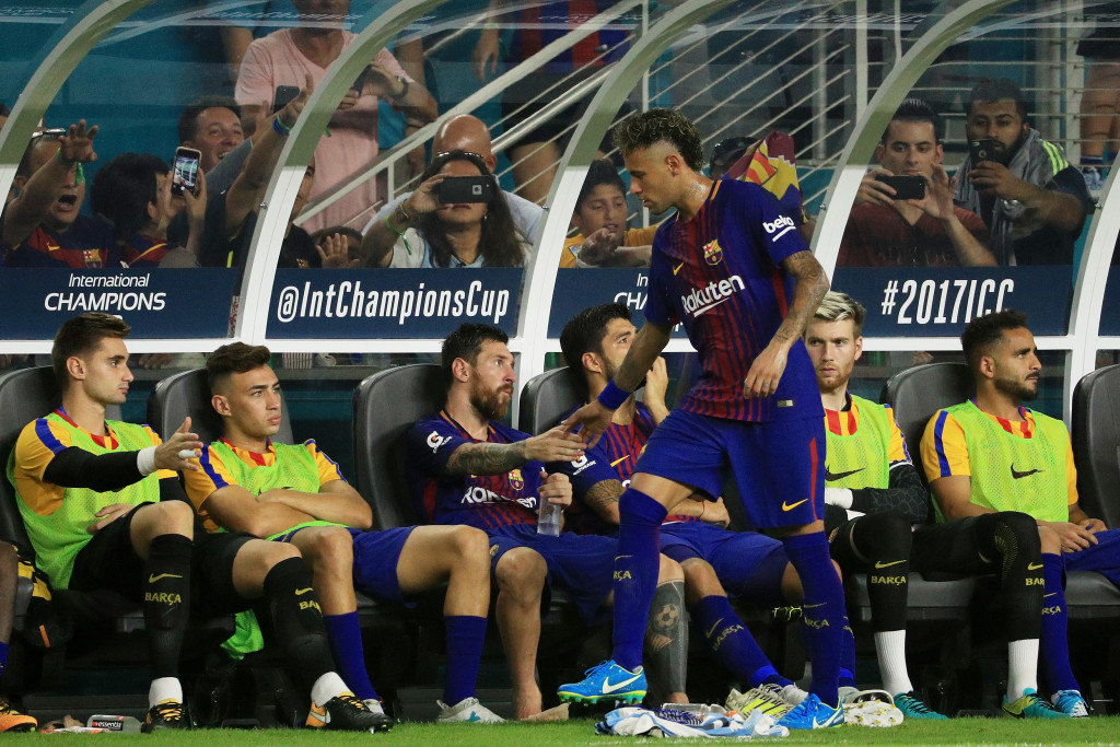 MIAMI GARDENS, FL - JULY 29: Lionel Messi #10 greets Neymar #11 of Barcelona as he comes to the bench during their International Champions Cup 2017 match against Real Madrid at Hard Rock Stadium on July 29, 2017 in Miami Gardens, Florida. (Photo by Mike Ehrmann/Getty Images)