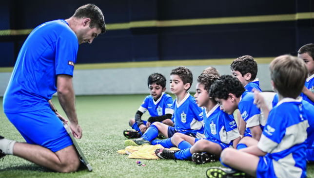 Every day is a school day: Coaches teach budding footballers.