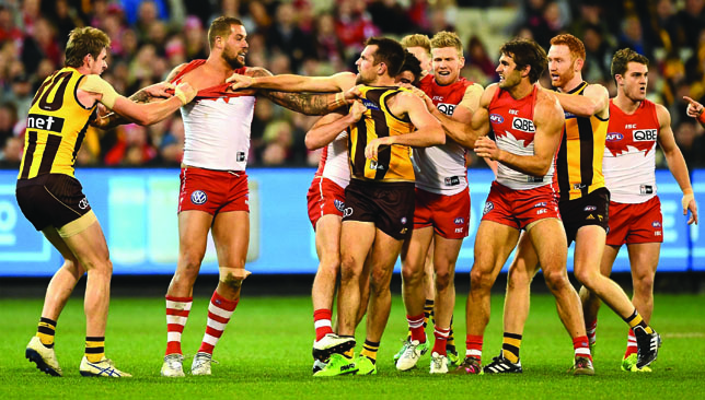 Lance Franklin (2nd l) and Luke Hodge (3rd l) face off in the torrid MCG encounter.