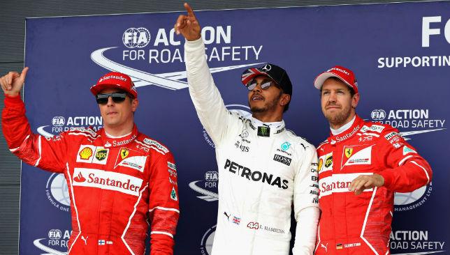 Lewis Hamilton (C) , Kimi Raikkonen (L) and Sebastian Vettel (R).