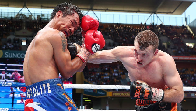 Aussie grit: Jeff Horn, with a cut above his right eye, unloads a fierce right-hand on Manny Pacquiao