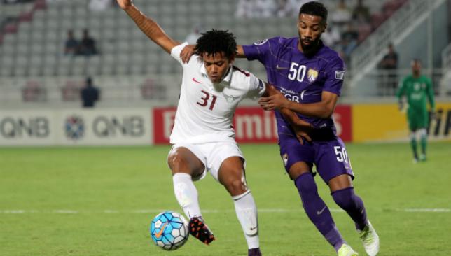 Samba star: Romarinho (l) in action against Al Ain (Getty).