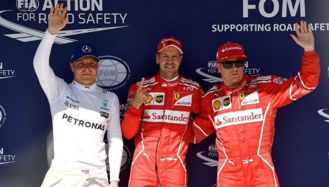 Sebastian Vettel (C), Kimi Raikkonen (R) and Valtteri Bottas (L).