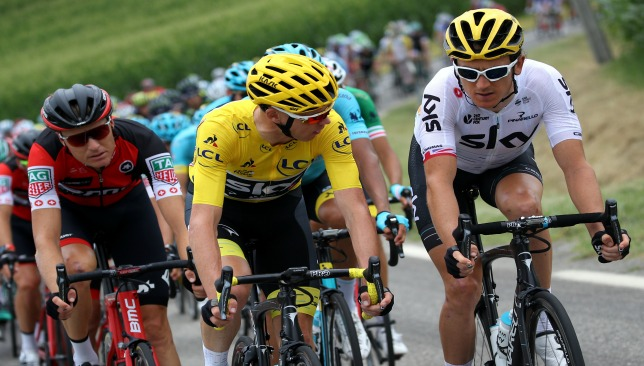Geraint Thomas (r) talks to Team Sky teammate Chris Froome on the early stages of Stage 9 before crashing out