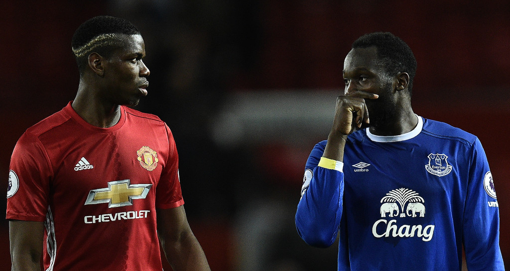 Manchester United's French midfielder Paul Pogba (L) and Everton's Belgian striker Romelu Lukaku leave the pitch following the English Premier League football match between Manchester United and Everton at Old Trafford in Manchester, north west England, on April 4, 2017. The match ended in a draw at 1-1. / AFP PHOTO / Oli SCARFF / RESTRICTED TO EDITORIAL USE. No use with unauthorized audio, video, data, fixture lists, club/league logos or 'live' services. Online in-match use limited to 75 images, no video emulation. No use in betting, games or single club/league/player publications. / (Photo credit should read OLI SCARFF/AFP/Getty Images)
