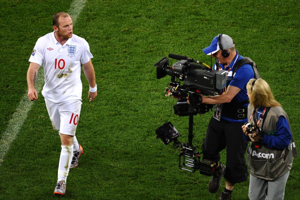 England's striker Wayne Rooney talks to