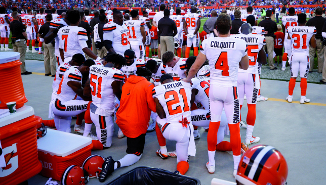 Together: Cleveland Browns player kneel for prayer during the national anthem. Picture: Getty Images.
