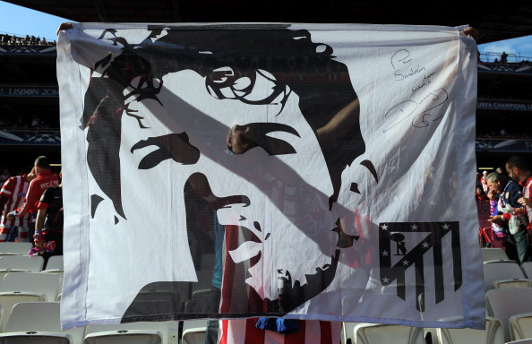 An Atletico de Madrid fan holds up a Diego Costa banner