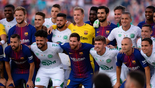 The two teams embrace before kick-off at Camp Nou.