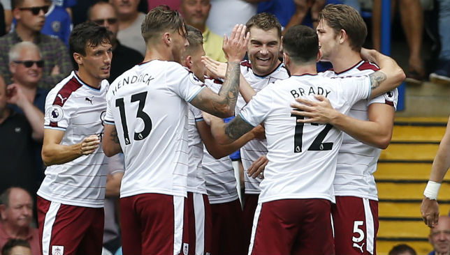 Burnley's Sam Vokes (C) celebrates his goal with teammates.
