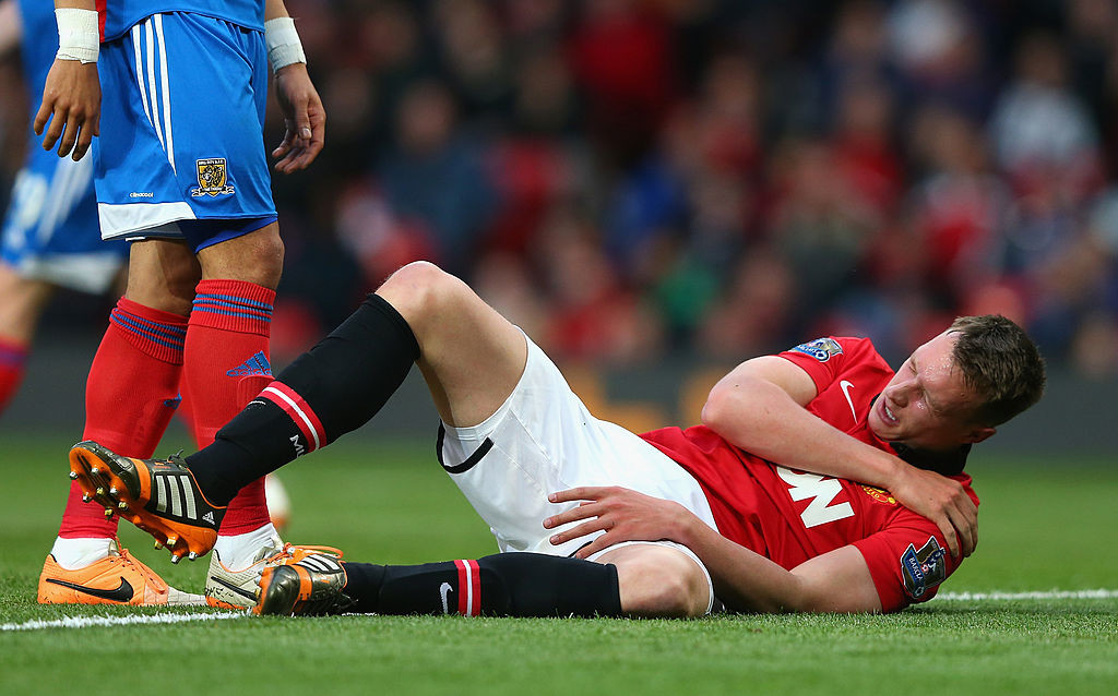 MANCHESTER, ENGLAND - MAY 06: Phil Jones of Manchester United holds his shoulder after sustaining an injury during the Barclays Premier League match between Manchester United and Hull City at Old Trafford on May 6, 2014 in Manchester, England. (Photo by Alex Livesey/Getty Images)