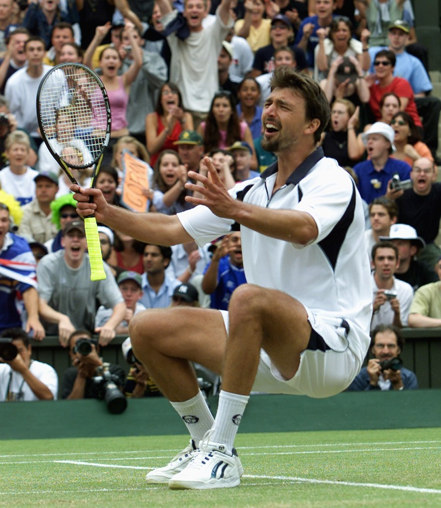 LONDON, UNITED KINGDOM: Croatian player Goran Ivanisevic celebrates after winning Men's Single Final against Patrick Rafter of Australia at the All England Tennis Championships in Wimbledon, 09 July 2001. Ivanisevic won 6-3, 3-6, 6-3, 2-6, 9-7. AFP PHOTO/GERRY PENNY (Photo credit should read GERRY PENNY/AFP/Getty Images)