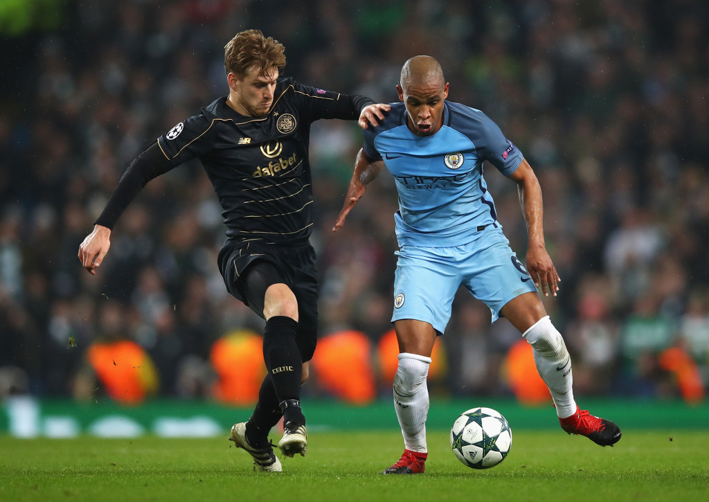 MANCHESTER, ENGLAND - DECEMBER 06: Stuart Armstrong of Celtic (L) and Fernando of Manchester City (R) battle for possession during the UEFA Champions League Group C match between Manchester City FC and Celtic FC at Etihad Stadium on December 6, 2016 in Manchester, England. (Photo by Clive Brunskill/Getty Images)