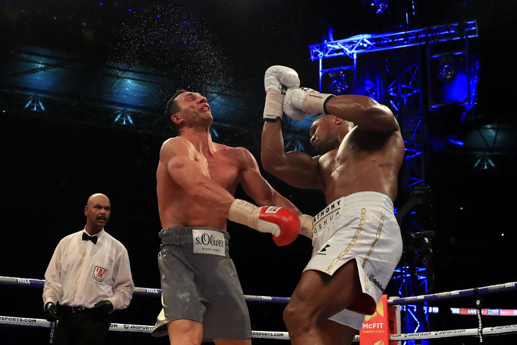 LONDON, ENGLAND - APRIL 29: Anthony Joshua (White Shorts) catches Wladimir Klitschko (Grey Shorts) with a right hand upper cut in the 11th round of their IBF, WBA and IBO Heavyweight World Title bout at Wembley Stadium on April 29, 2017 in London, England. (Photo by Richard Heathcote/Getty Images)