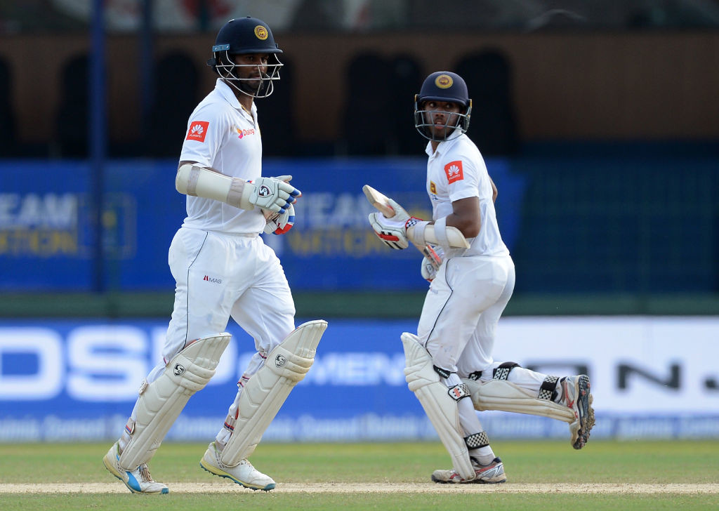 Centuries from Mendis and Karunaratne led Sri Lanka's defiance.