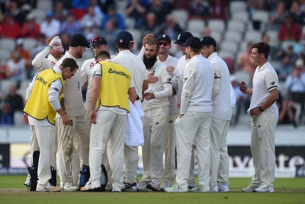 Ali is mobbed by his teammates after dismissing Hashim Amla