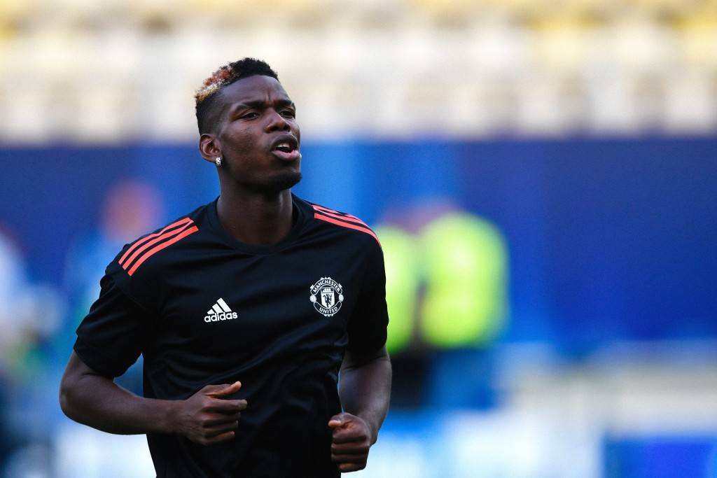 Manchester United's midfielder Paul Pogba warms up during a training session ahead of the UEFA Super Cup 2017 football match between Real Madrid and Manchester United at the National Arena Filip II in Skopje on August 7, 2017. Cristiano Ronaldo could feature against his former club Manchester United in Tuesday's UEFA Super Cup after being included in Real Madrid boss Zinedine Zidane's squad for the trip to Skopje, Macedonia. / AFP PHOTO / DIMITAR DILKOFF (Photo credit should read DIMITAR DILKOFF/AFP/Getty Images)