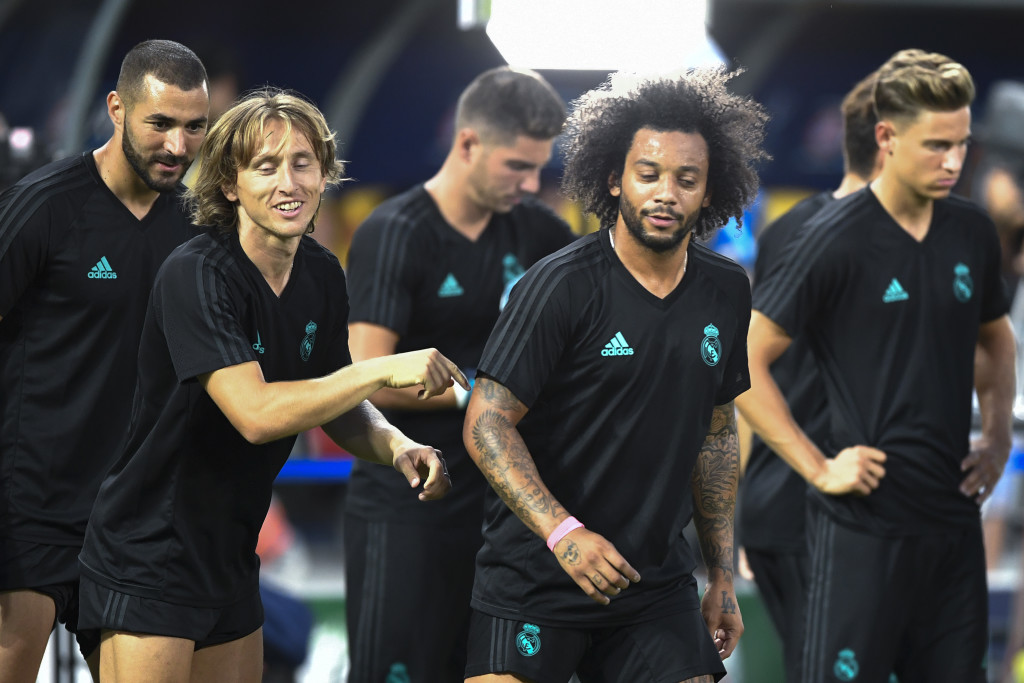 Real Madrid's midfielder Luka Modric (L) and Real Madrid's defender Marcelo (R) warm up during a training session ahead of the UEFA Super Cup 2017 football match between Real Madrid and Manchester United at The National Arena Filip II in Skopje on August 7, 2017. / AFP PHOTO / DIMITAR DILKOFF (Photo credit should read DIMITAR DILKOFF/AFP/Getty Images)
