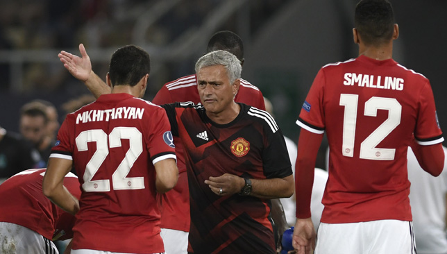 Jose Mourinho chats to his players during the Super Clash clash against Real Madrid