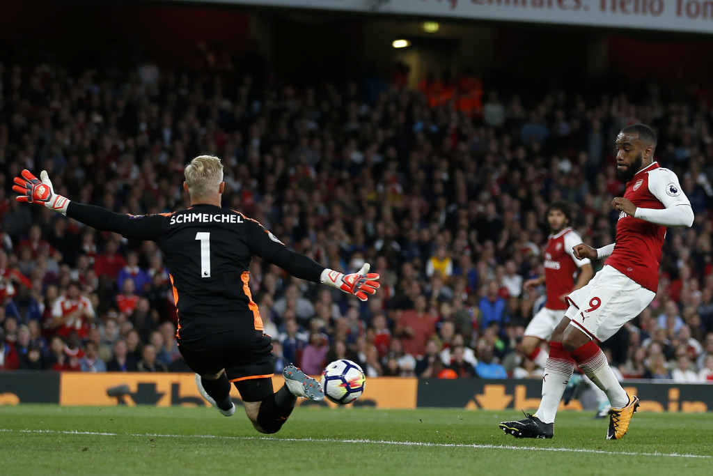 Lacazette has this shot saved by Schmeichel