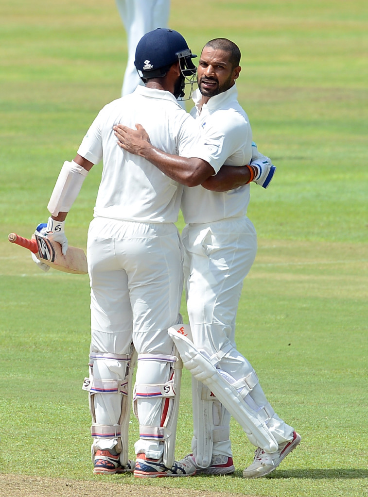 Indian cricketer Shikhar Dhawan (R) is congratulated by his teammate Cheteshwar Pujara after he scored a century (100 runs) during the first day of the third and final Test match between Sri Lanka and India at the Pallekele International Cricket Stadium in Pallekele on August 12, 2017. / AFP PHOTO / LAKRUWAN WANNIARACHCHI (Photo credit should read LAKRUWAN WANNIARACHCHI/AFP/Getty Images)